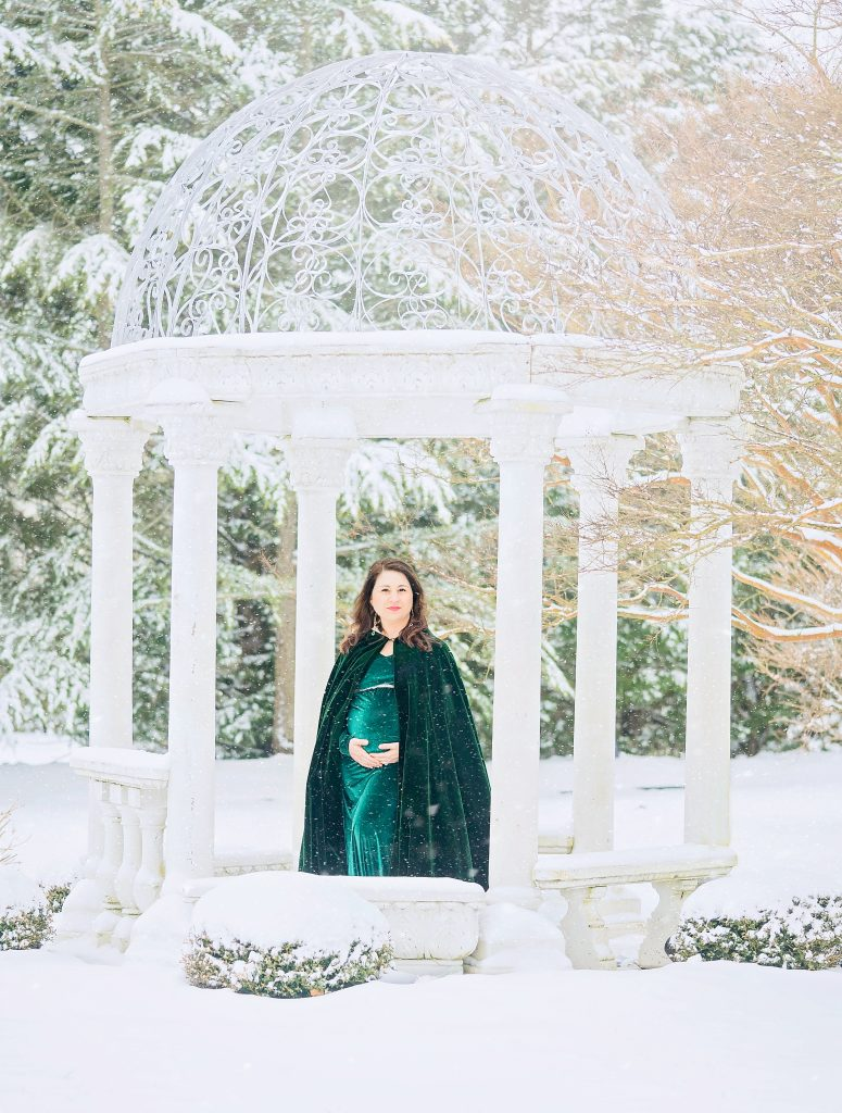 Snow Day Maternity picture with green velvet Maternity Gown and Dramatic Architecture by Lin Ellen Studios in South Jersey