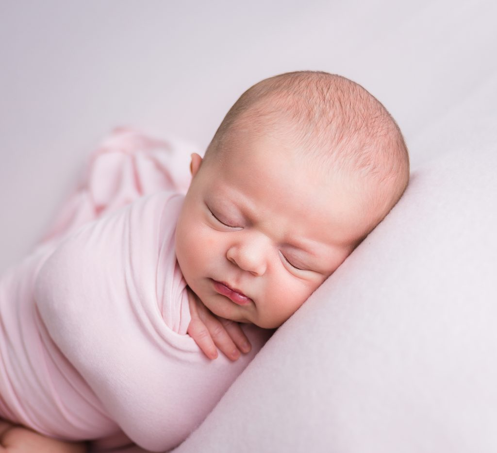 Baby Sleeping wrapped in Pink by Lin Ellen Studios in Vineland New Jersey.
